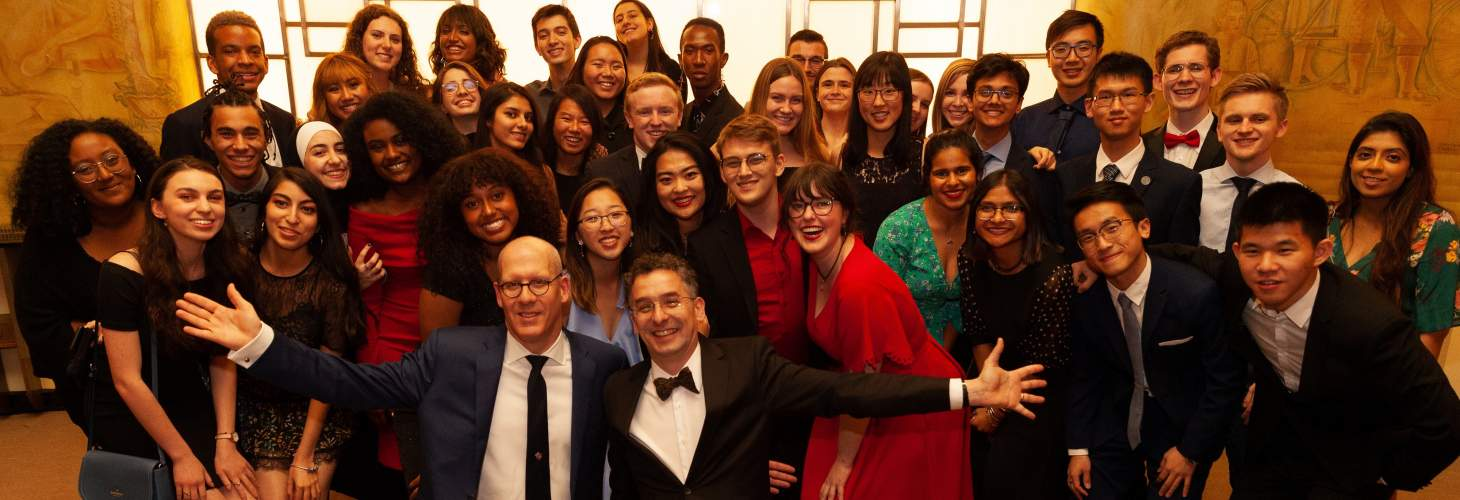UC Students celebrate with Principal's Donald Ainslie and Markus Stock at the 2019 Alumni of Influence Awards Gala
