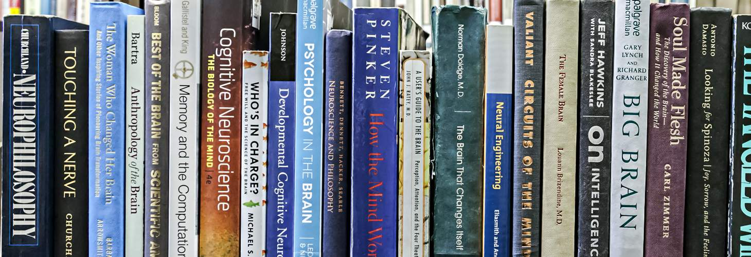 shelf of books related to Cognitive Science