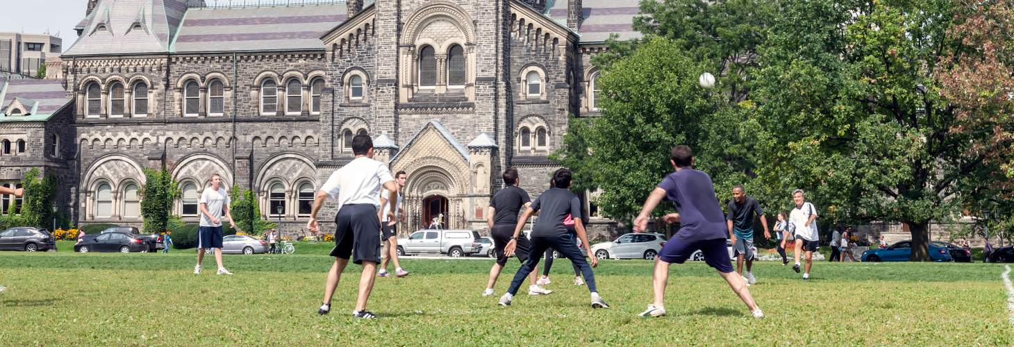 Students Playing Soccer in front of UC Building