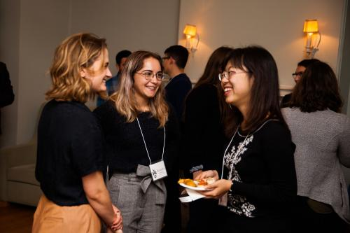 students and alumni mingling during a networking event