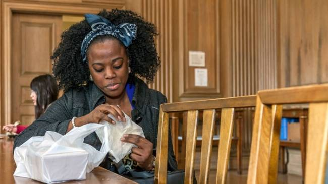 Woman eats at Howard Ferguson Dining Hall