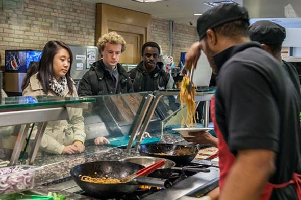 Students ordering food at the stir-fry station