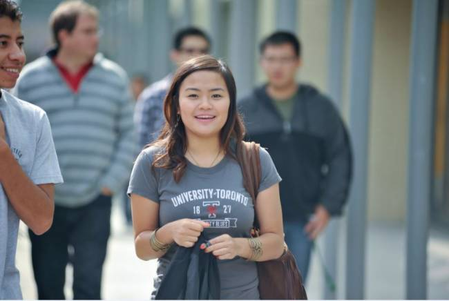 Student walking on the St. George Campus