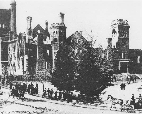 Damaged University College with pedestrians, carriages, and trees in foreground