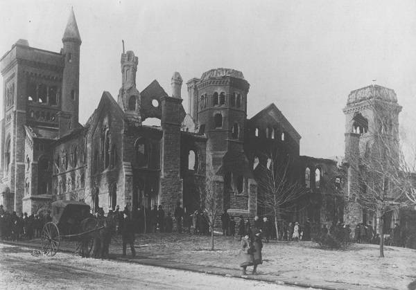 Damaged University College with pedestrians in foreground