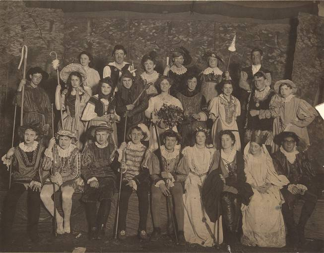 Group portrait of about 25 actors in costume.
