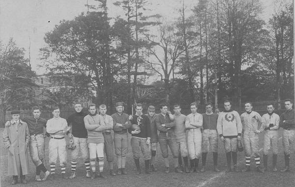 About 20 young men on a playing field