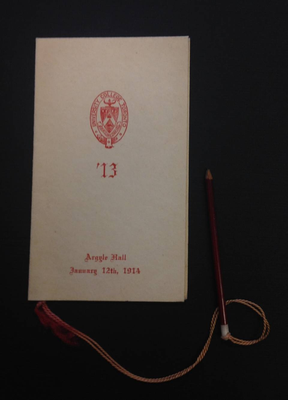 "Front cover of a dance card with University College logo and the words ""Argyle Hall, January 12th, 1914"""