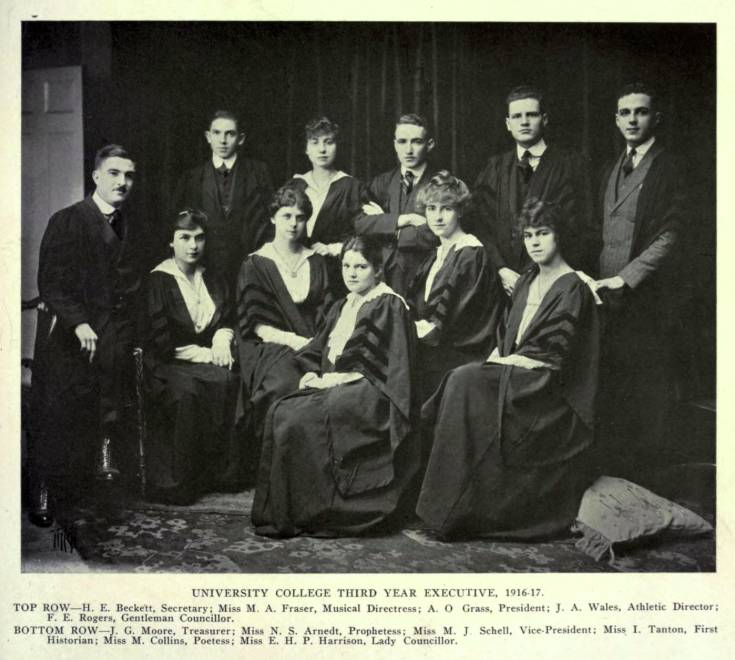 Six women and five men wearing academic robes