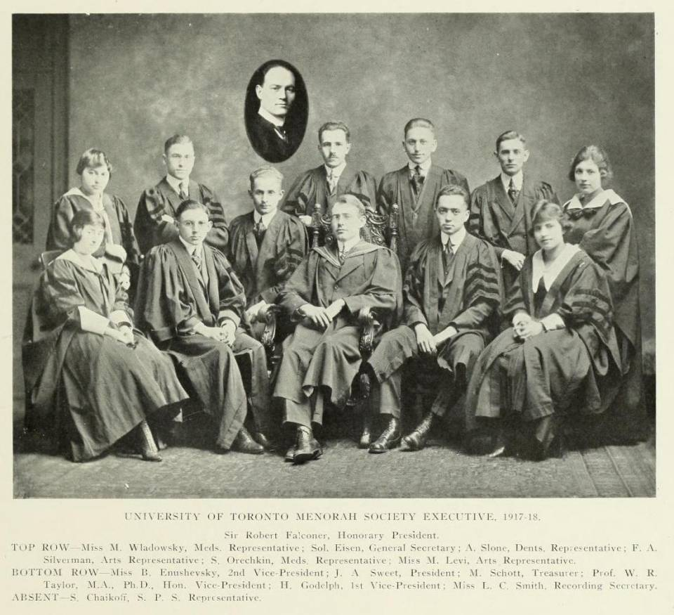 "About a dozen students in academic robes, with the caption ""University of Toronto Menorah Society Executive, 1917-18"" and their names and positions"