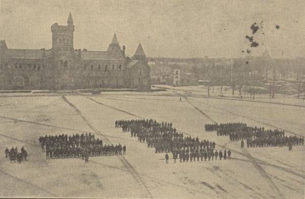 Distant view of rows of soldiers with University College in background