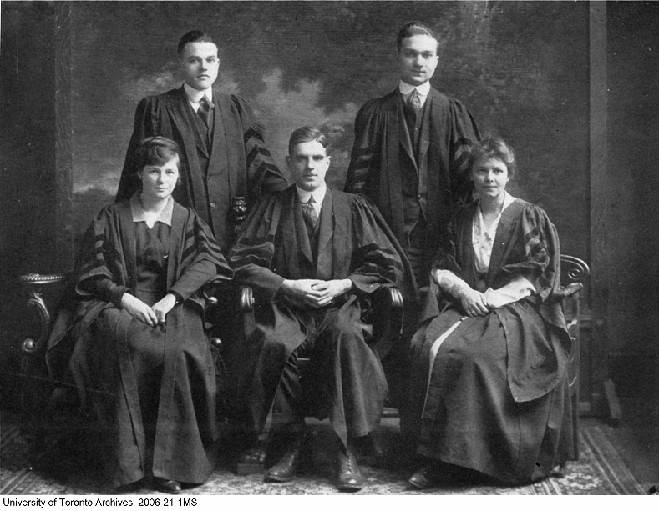 group portrait of three men and two women in academic robes