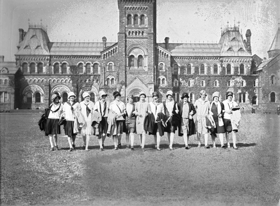 About 15 young women on front campus, with University College behind them