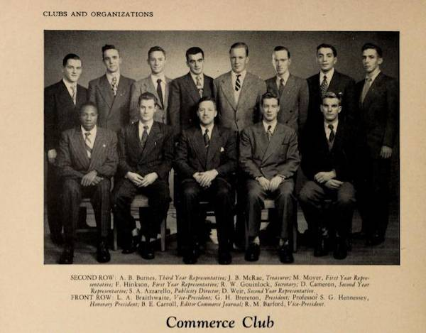 "Yearbook photo of thirteen men in suits, captioned ""Commerce Club"""