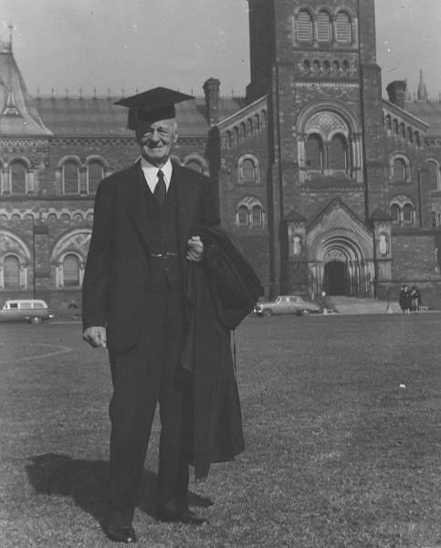 Malcolm Wallace wearing mortarboard in front of University College