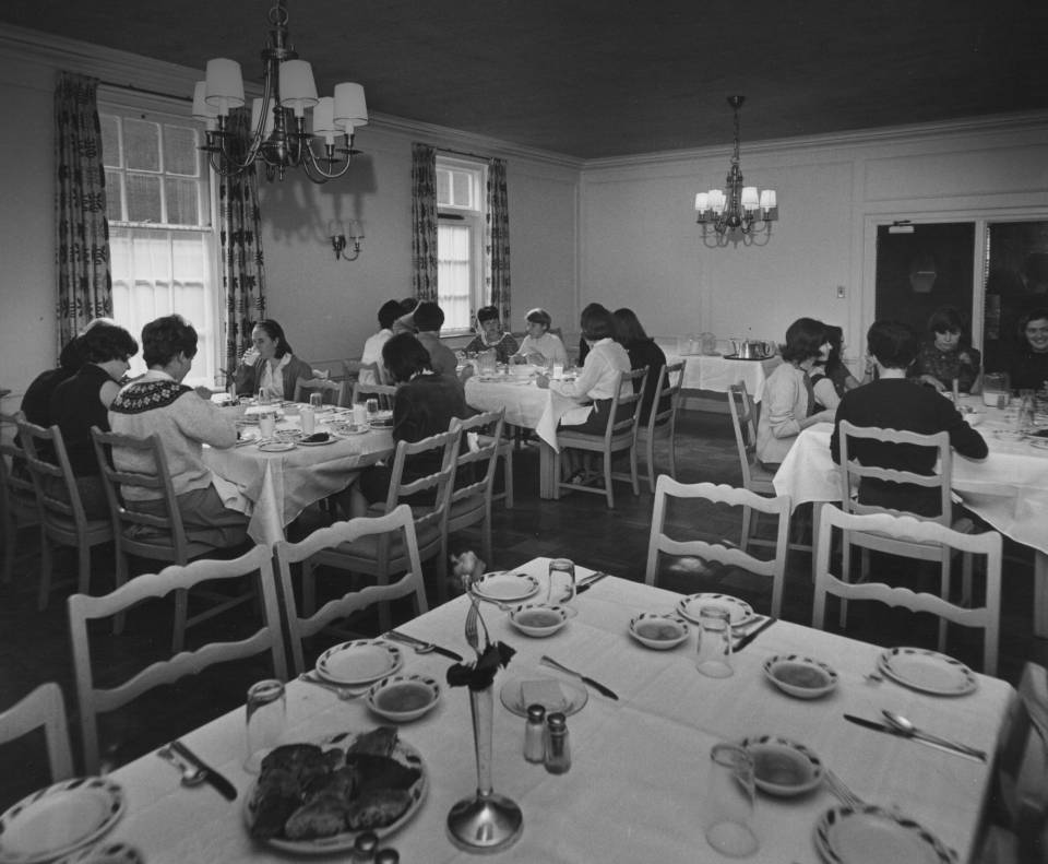 About 15 women eating at dining tables