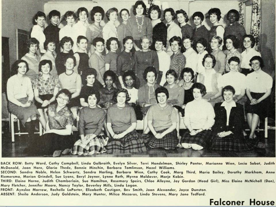 about 50 women in 4 rows, with their names listed below